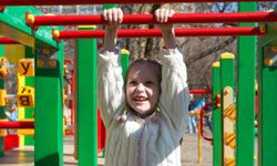 Climbing monkey bars is a fun and healthy activity for your child.