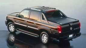 An innovative midgate was introduced with the 2002 Escalade EXT.