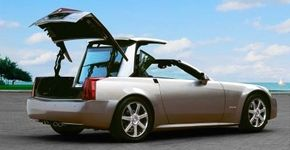 The 2004 Cadillac XLR boasted a power-retracting solid roof that pirouetted into the trunk.