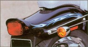 The paint scheme of the 2002 Harley-Davidson FXDWG3 is accentuated with flames.