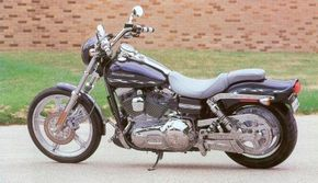 The 2002 Harley-Davidson FXDWG3 features a factory custom look. See more motorcycle pictures.