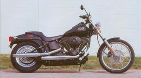 The crinkle-black trim of the 2002 Harley-Davidson FXSTB Night Train makes this Harley-Davison model unique. See more motorcycle pictures.
