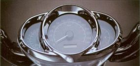 The speedometer on the 2002 Harley-Davidson VRSCA V-Rod is housed in a pod-like instrument panel.