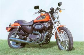 The 2002 Harley-Davidson XL-883R Sportster features paint and tank decals fashioned after those of the company's XR-750 dirt trackers of the 1970s. See more motorcycle pictures.