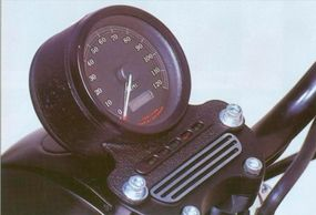 The 2002 Harley-Davidson XL-883R Sportster speedometer features a satin-black crinkle finish.