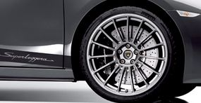 The Superleggera's exterior features multi-spoke 19-inch Speedline wheels, and dark accents for the headlamps, front air intakes, and exhaust pipes.