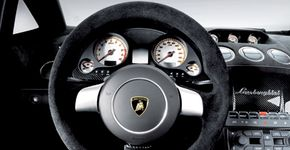 Carbon fiber is the material of choice for the Superleggera's center console, seat shells, and interior door panels.