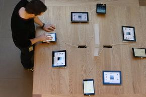 An Apple employee uses the iPad mini at the tablet's launch in the UK in November 2012.