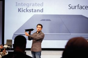 A Microsoft Surface design team member shows off the new tablet at a news conference in the summer of 2012.