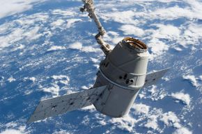 Victory! Earth forms the backdrop for this image, featuring Dragon-2 in the grasp of the International Space Station's Remote Manipulator System or Canadarm2 in March 2013.