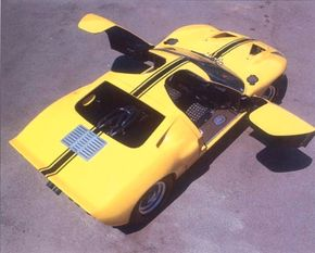 A faired-in spoiler at the trailing edge of the deck also helped keep Ford GT-40s planted on the pavement. Door cuts that extended deeply into the roof eased entry and exit for drivers.