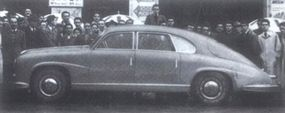 The motoring press got its first peek at the car at the 1947 Mille Miglia. By then, a front-mounted radiator was fitted and Zagato had revised the bodywork.