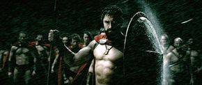 Leonidas (Gerard Butler) uses his shield as shelter from the fierce storm that heralds the arrival of the Persian army to Green shores.