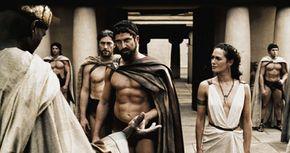 Leonidas (Gerard Butler, center) warns the Persian Messenger (Peter Mensah) to choose his words wisely as Captain (Vincent Regan, left) and Gorgo (Lena Headey) look on.