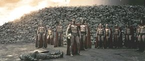 Astinos (Tom Wisdom, third from left), Leonidas (Gerard Butler) and his Captain (Vincent Regan) look toward the distant Persian encampment as a wall of the day's dead rises behind them.