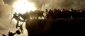 As the Spartan phalanx led by Leonidas (Gerard Butler, center) advances, the rear column of attacking Persians falls over the cliff's edge and into the sea below.