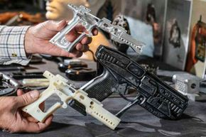 Walter Klassen holds a fantasy gun that actually fires blanks, which he created on his 3-D printer.