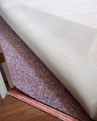 This purple carpet pad will be laid between the carpet and the floor.