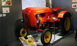 """A Porsche tractor from the 1950's is presented in the special exhibition, """"Main Issue Labor - Change in the labor world after 1945,"""" in the House of German History in Bonn, Germany."""