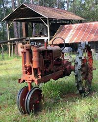 An old Farmall tractor stands idle at the McCranie Brothers turpentine still in Willacoochee, Ga.