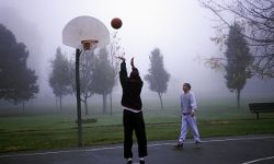 Behind the free-throw line, through the fog, off the backboard.