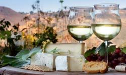 White wines, such as chardonnay, go well with mild cheeses.