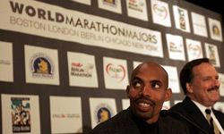Mebrahtom Keflezighi, U.S. Olympic Marathon silver medalist, left, is seen with Guy Morse, executive director of the Boston Marathon, right, during a news conference in Boston, Jan. 23, 2006, to announce the formation of the World Marathon Majors.
