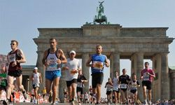 Runners pass the Brandenburg Gate during the 36th Berlin Marathon in Berlin, Germany, Sunday, Sept. 20, 2009. Some 40,000 runners take part in the competition.