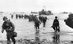 American assault troops move onto a beachhead during the D-Day invasion of German-occupied France on the beach of Normandy, June 7, 1944.