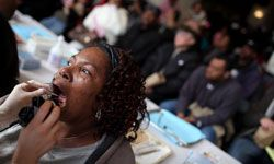 A woman has her teeth examined at a free clinic in Oakland, Calif.