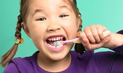 Your kid probably doesn't look forward to brushing her teeth, but that'll change if you sing a song or make up a game about it.