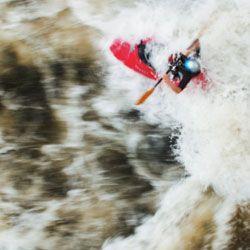 "A kayaker takes on an eddy called ""Hell Hole"" on the Ocoee."