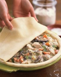 Once all the ingredients are assembled inside the crust, just cover the pie and bake!