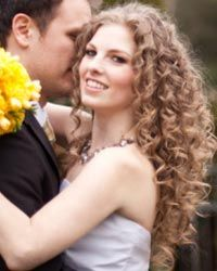 If your hair is naturally curly like this bride's is, flaunt your fabulous tresses.