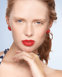Yes, even classic bright red lipstick is best paired with neutral makeup tones.
