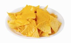 Basic nachos are just chips and cheese, but with the right toppings, they can be a filling meal.