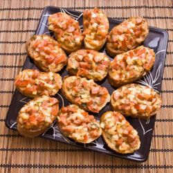 You can make mini pizzas on anything from slices of French bread to tortillas. Of course, pizza dough works, too.
