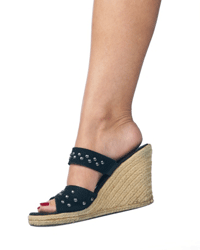 Wedge sandals are still hip, though studded black leather is not usually seen as cutting-edge fashion.