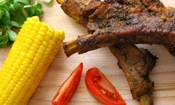 You'd be hard-pressed to find a more traditional Deep South meal than barbecue, corn and tomatoes.