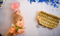 Relive prom night with pink punch and corsages.