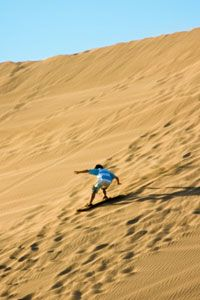 If you want to go beyond water skiing and snowboarding, consider sandboarding for your next adventure.