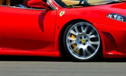Racing exotic cars, like Ferraris, may offer something a little more thrilling than the typical race car driving experience.