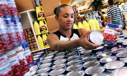 Liz Cintron buys canned goods at a Publix Store Sept. 2, 2004, in Orlando, Fla. Some of these everyday foods have a surprisingly high sodium content. See more boxed food pictures.