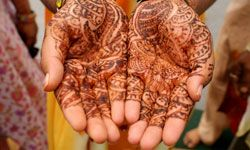 An Indian bride's hands decorated with henna.