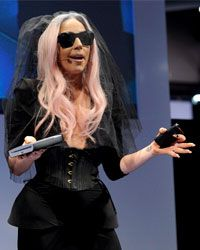 Lady Gaga shows off her portable Polaroid printer at the 2011 Consumer Electronics Show.