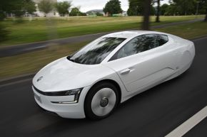 Volkswagen will introduce an augmented reality interface called MARTA for its upcoming VW XL1 -- an all-new, fuel-efficient, aerodynamic production car which features an intricate diesel-hybrid drivetrain.
