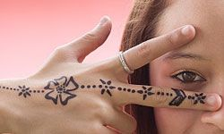 There are many ways to add some cultural enhancements to a bridal shower. If the mom-to-be is from India, for example, you could give each other henna tattoos.