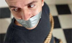 Duct tape: the right tool for keeping this guy quiet.