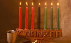 The black candle in the center is lit by itself on the first night of Kwanzaa and together with a red or green candle each night thereafter.