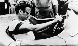 """James Dean, seen here in a still from the 1957 documentary movie """"The James Dean Story,"""" had a passion for sports cars."""
